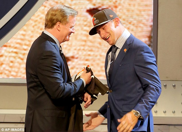 Johnny Manziel hugs NFL Commissioner Roger Goodell after being selected by the Cleveland Browns