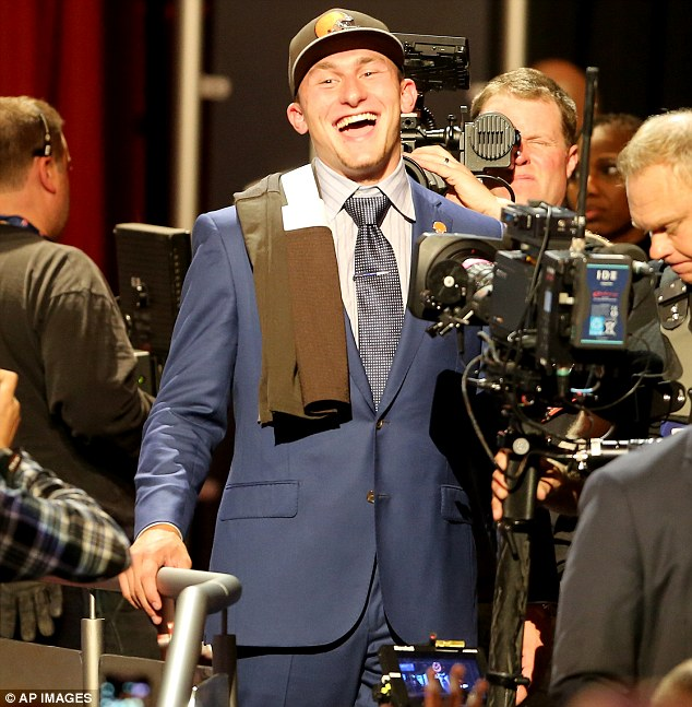 Early pick: Other quarterbacks, including Johnny Manziel who is pictured after getting selected for the Cleveland Browns, have already had the call