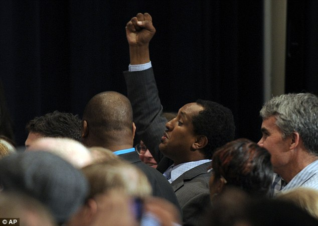 Free speech: A man shouts at President Barack Obama as Obama speaks at a Democratic National Committee reception in San Jose, California on Thursday