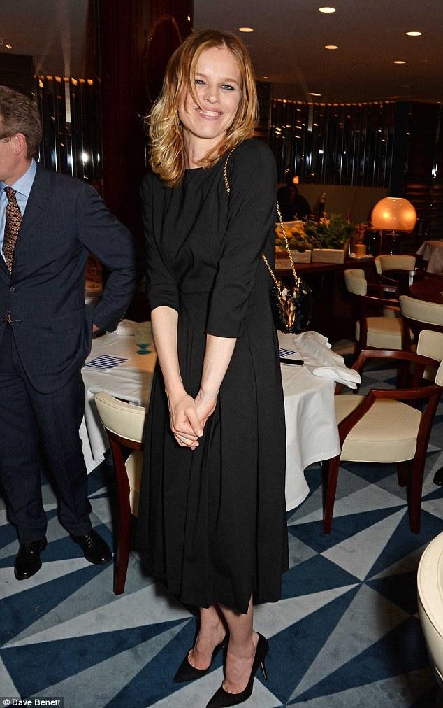 Million dollar smile: Eva Herzigova was formal and chic in all black