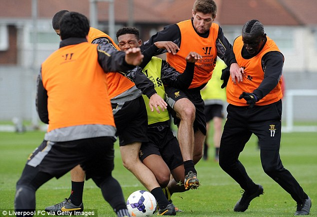 Scramble: Gerrard (second right) fights for the ball with team-mates Sakho (right) Jordan Ibe (centre) and Conor Coady as Luis Suarez looks on