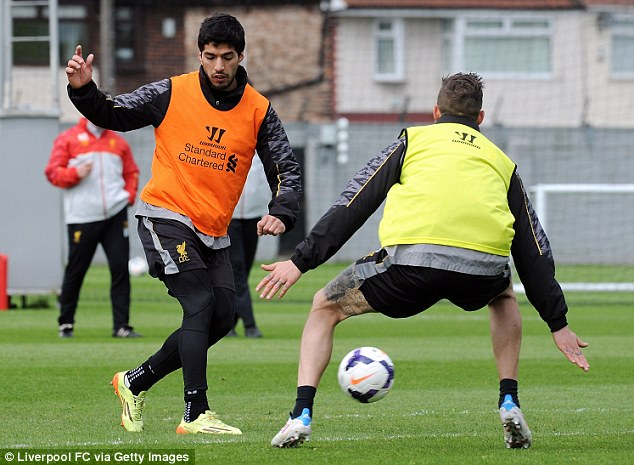 Show the skills: Luis Suarez takes on Daniel Agger during Friday's training session