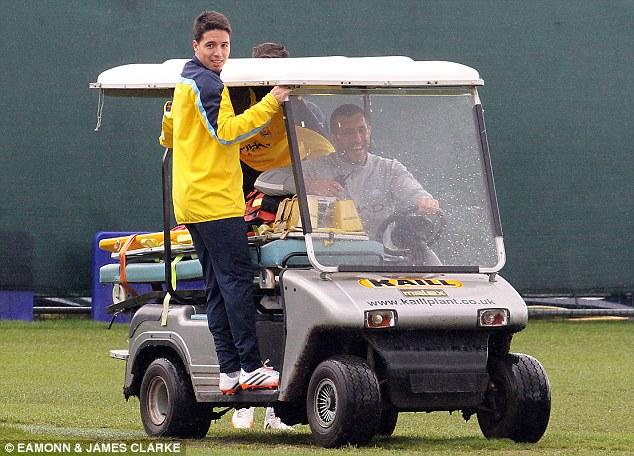 Hitchin' a ride: City's Samir Nasri catches a lift out on to the training pitch