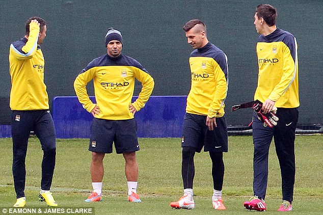 Stand and deliver: Aguero looked in good spirits during training as he prepared for a City first-team return