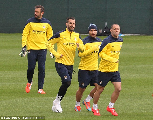 Ready for the run-in: Aguero (second right) jogs in training with Pablo Zabaleta (right) and Alvaro Negredo