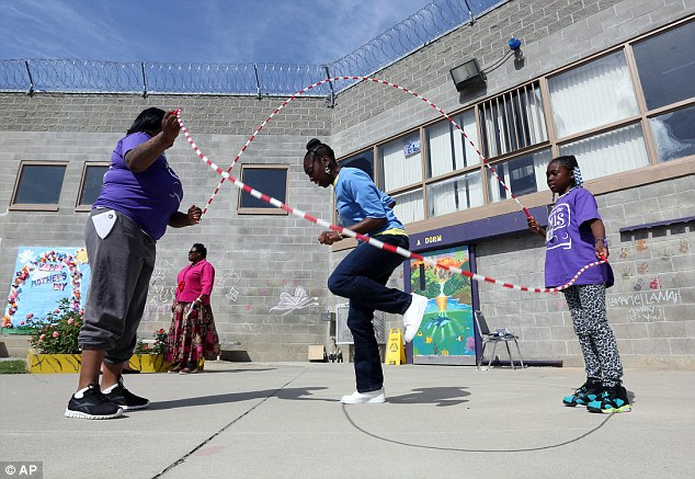 Taryn Mitchell, center, plays jump rope with her daughter, Lamariae Williams, 10, right, and cousin Schelette Butler during their visit at the Folsom Women's Facility where children were able to play games with their incarcerated parents
