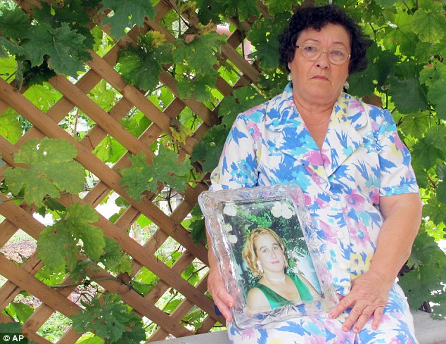 Closure: Hermila Garcia, pictured holding a photo of her daughter, says the family feel robbed of justice