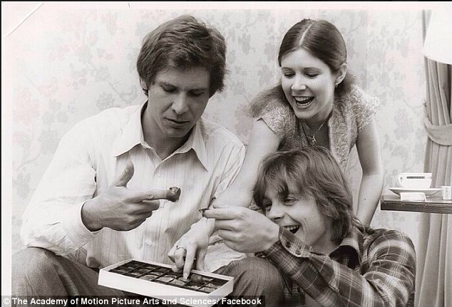 Life is sweet: Harrison Ford, Carrie Fisher and Mark Hamill can be seen eating a box of chocolates in rare photos from the set of Star Wars, which belong to Carrie