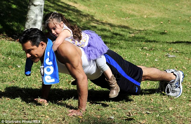 Personal trainer: Mario Lopez was out through his paces by daughter Gia on Friday in Los Angeles, California