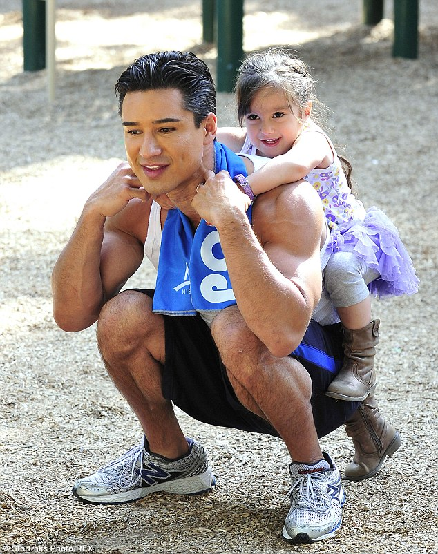 Fun reward: It was not all work and no fun for world's little's personal trainer, the toddler was also treated to a piggyback ride by her father