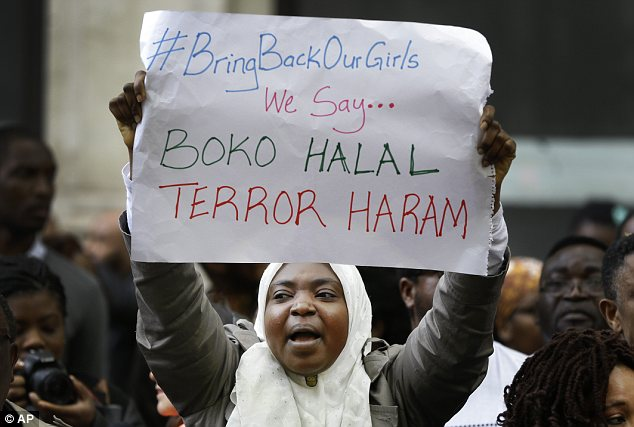 Global protests: Demonstrators yelled Friday in London, showing a play on words that reverses the meaning of Boko Haram -- 'Western education is permitted; Terror is sinful,' it reads