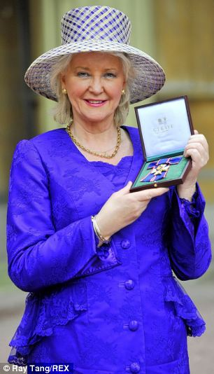 Angela Kelly, the Queen's Curator for 'Jewellery, Insignia and Wardrobe', has developed a very close relationship with Her Majesty (Mrs Kelly pictured receiving the Royal Victoria Order Investitures at Buckingham Palace)