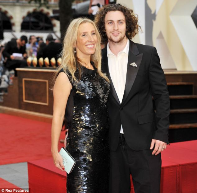 Photographer Sam Taylor-Wood with her husband Aaron Taylor-Johnson arrives at the 'Anna Karenina' Film Premiere in London in 2012