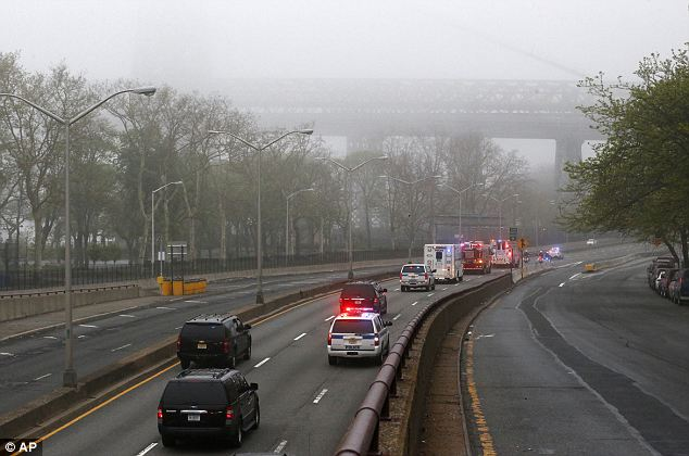 Procession: The remains were accompanied by police and fire department vehicles with lights flashing but no sirens