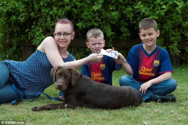 Shock: Donnah Dear, 37, and her sons Oliver, three, and Toby, six, with Murphy who ate £400 of their cash