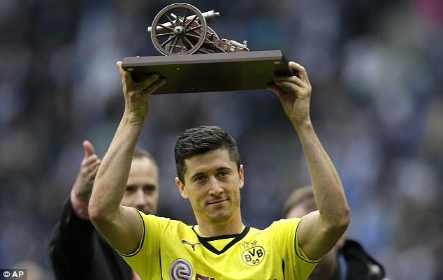 Winner: Robert Lewandowski secured the Bundesliga golden boot with two goals against Hertha