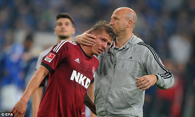 Down and out: Nuremberg were relegated after their 4-1 defeat against Schalke