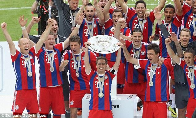Champions: Bayern Munich celebrate winning the Bundesliga as Philipp Lahm lifts the trophy