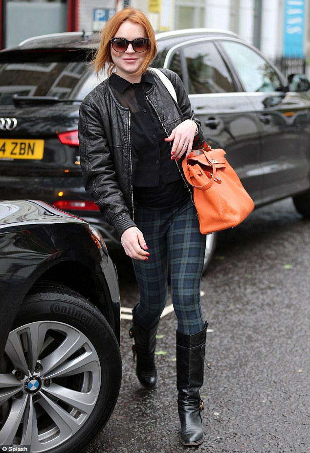 Treat time: Lindsay Lohan was seen paying a visit to a beauty salon in Notting Hill on Saturday