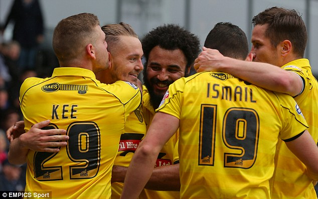 Togetherness: Burton Albion players celebrating McGurk's winner
