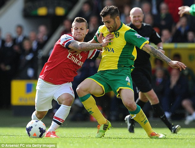 Perfect timing: Jack Wilshere makes his first appearance for Arsenal since breaking his foot in March