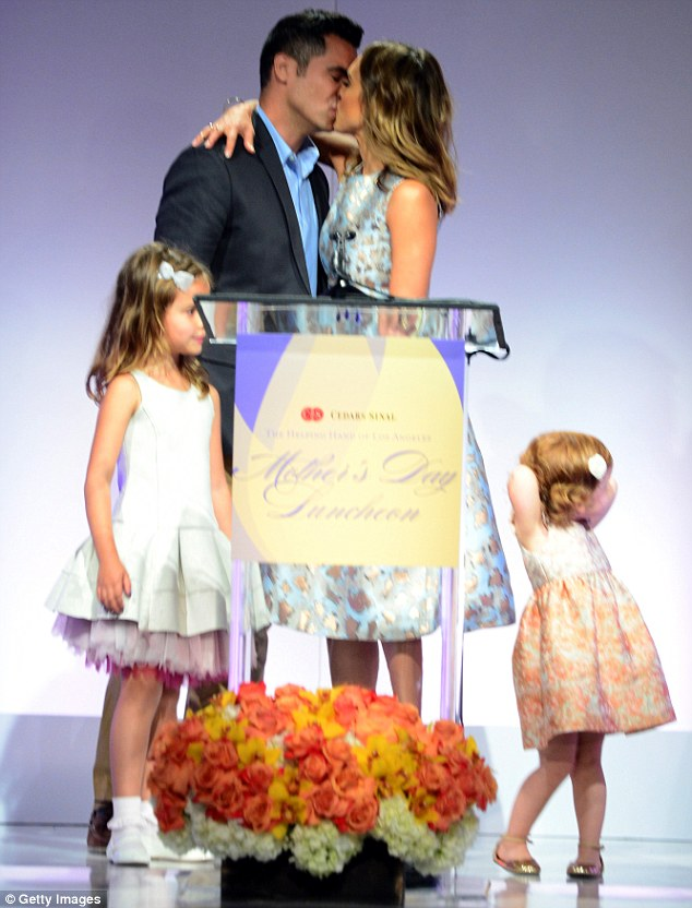 Starting things off right: Jessica received a kiss from Cash earlier on Friday as she was named Mother Of The Year at an event in Beverly Hills