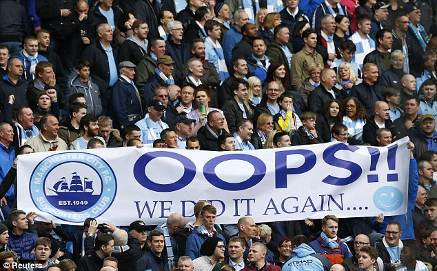 Sign of the times: City fans hold up a banner celebrating their second title win in three years