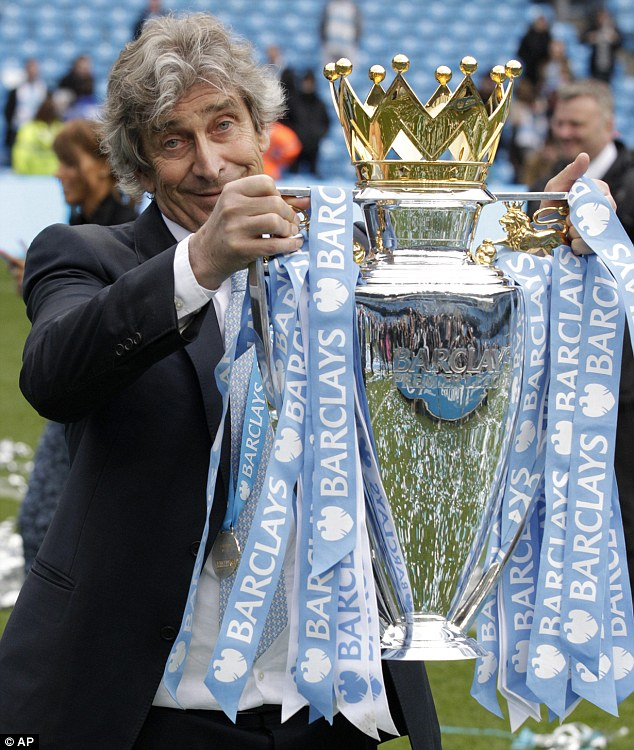 Proud moment: Pellegrini poses for photographers with a big grin on his face as he holds the trophy