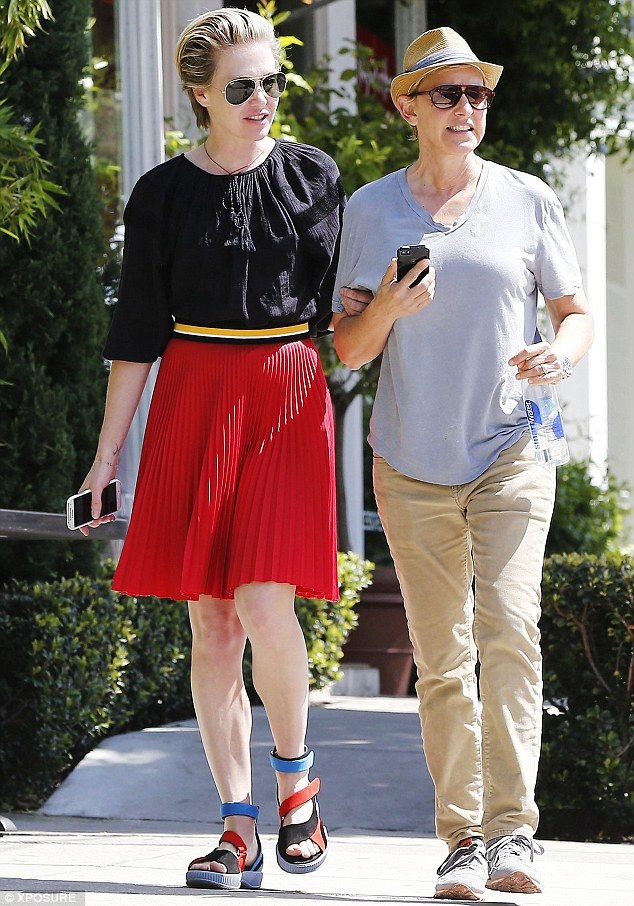 On a mission: Ellen DeGeneres and wife Portia Rossi strolled in the sunshine on their way to a book shop in West Hollywood on Saturday