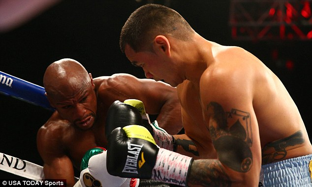 Lets do it again: Mayweather may fight Maidana in September, leaving Khan to wait until at least next May