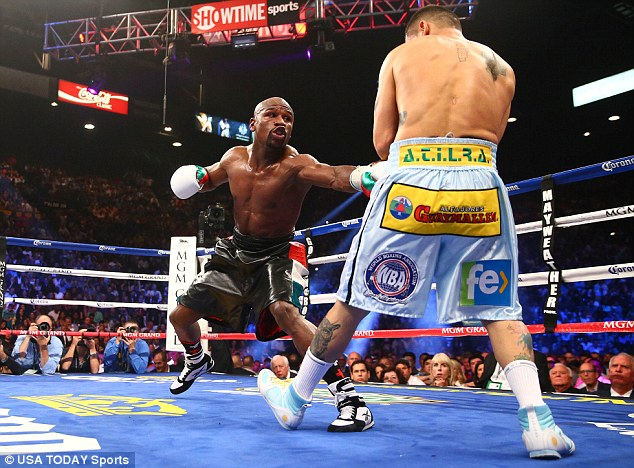 Still unbeaten: Mayweather was given a tough time as he outpointed Marcos Maidana earlier this month