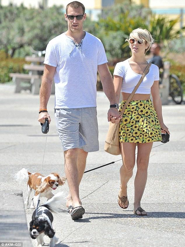 Splitting the duties: Both handled a dog leash during their sunny stroll