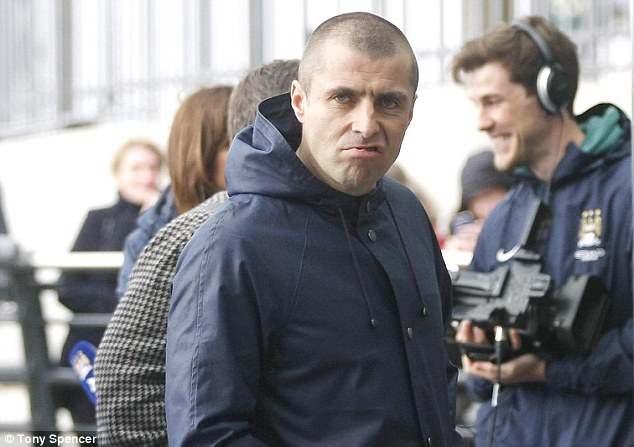 Matchday: Liam Gallagher pulls a face at the camera as he arrived at the Etihad Stadium for Sunday's match