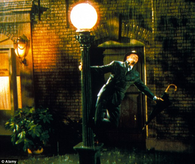 Classic: Gene Kelly in the hit film Singin' In The Rain, which remains a cult classic