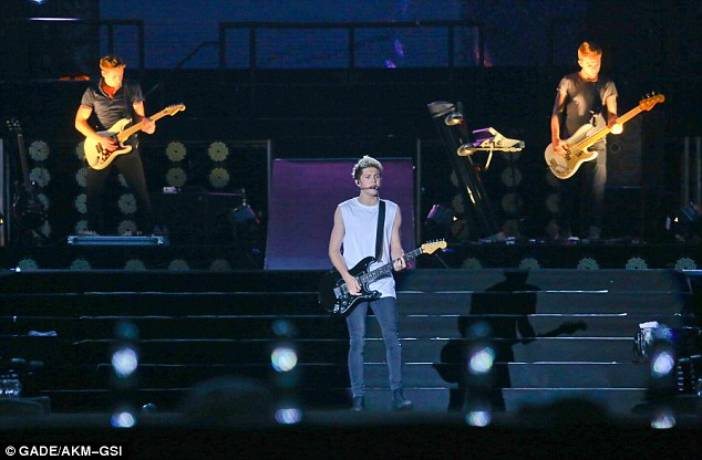 Welcome to Brazil! Speaking at the Estadio Morumbi, the World Cup winner told Niall Horan (pictured) and his bandmates: 'I play the guitar and one day we¿ll play together'