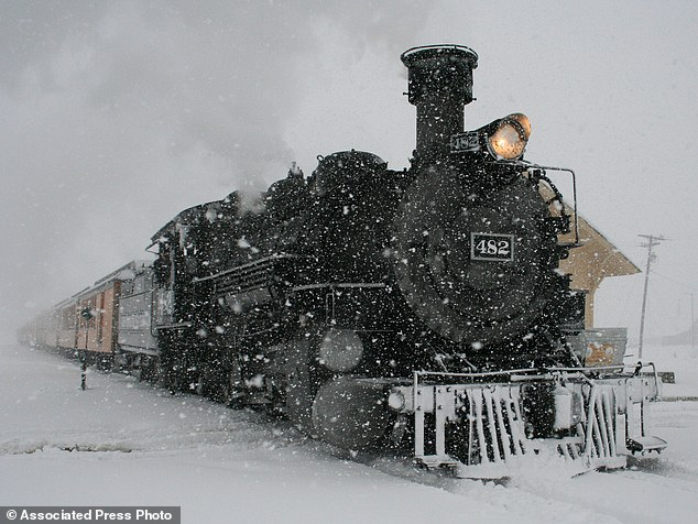 Dangerous routes: A Durango and Silverton Narrow Gauge Railroad passenger train arrives in Silverton, Colorado on Sunday in the snow