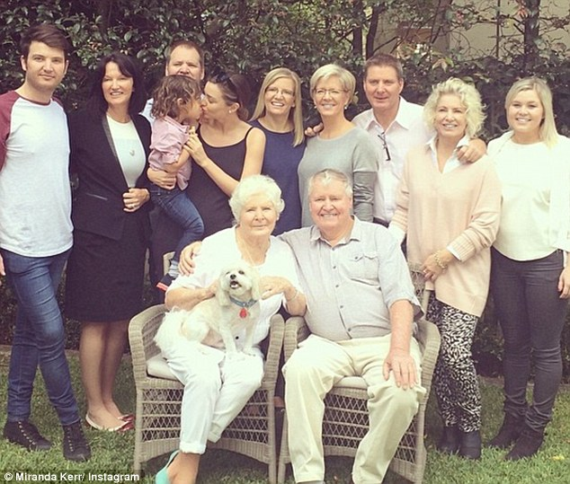 All together again: Miranda was reunited with her whole family in her hometown of Australia this weekend and credits her grandmother (pictured front left) for teaching her how to pray and be grateful