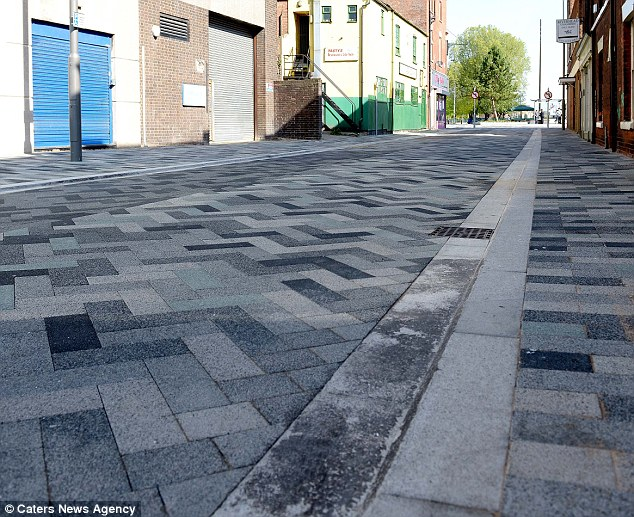 New design: Anne Heenan, 74, was walking along New Street in Grimsby when she slipped on the kerb. She says she failed to spot the gap because of the new colour scheme