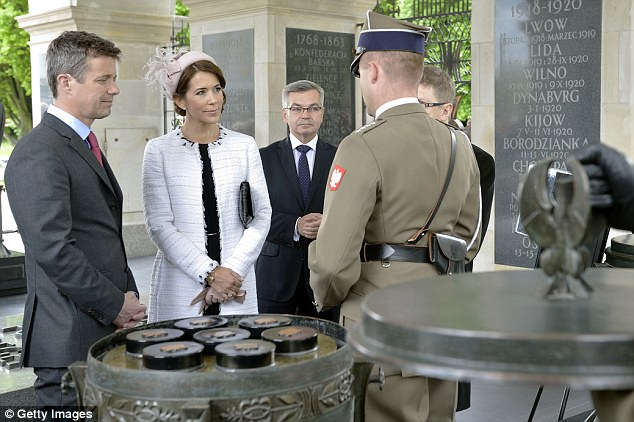 Frederik Crown Prince of Denmark (left) and his wife Crown Princess Mary (right) visit the Tomb of the Unknown Soldier as part of their visit