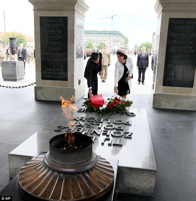 Denmark's Crown Prince Frederik, left, and Crown Princess Mary, right, attend a wreath laying ceremony at the Tomb of the Unknown Soldier in Warsaw