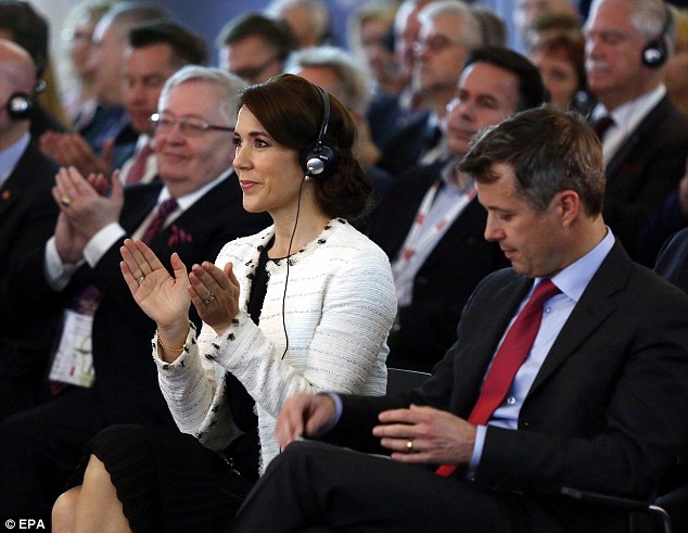 Crown Prince Frederik of Denmark (right) and his wife Crown Princess Mary (centre) attend the official opening of the exhibition 'Denmark and Poland - Cooperation and Innovation' at the Copernicus Science Center in Warsaw
