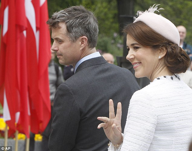 Crown Princess Mary of Denmark waves to people gathered at the Tomb of the Unknown Soldier