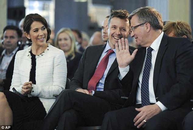 Denmark's Crown Prince Frederik, centre, talks with Polish President Bronislaw Komorowski, right, as Crown Princess Mary, left, watches