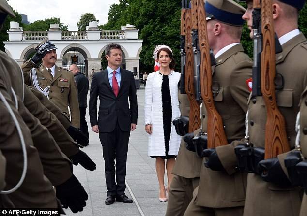 Crown Prince of Denmark Frederik (left) and Crown Princess Mary attend the wreath laying ceremony