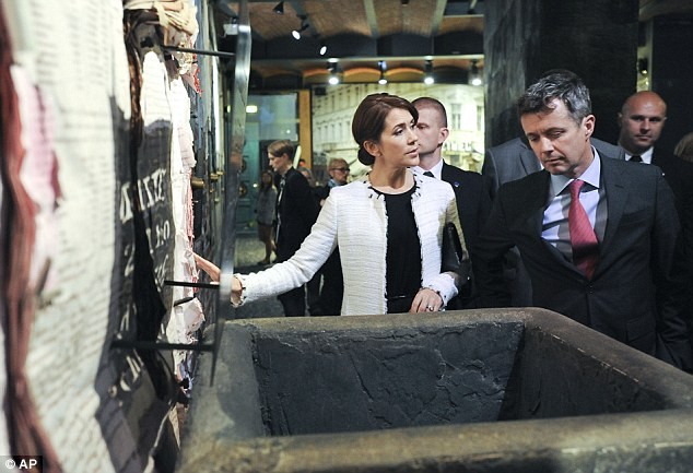 Denmark's Crown Prince Frederik, right, and Crown Princess Mary visit the Warsaw Uprising 1944 museum
