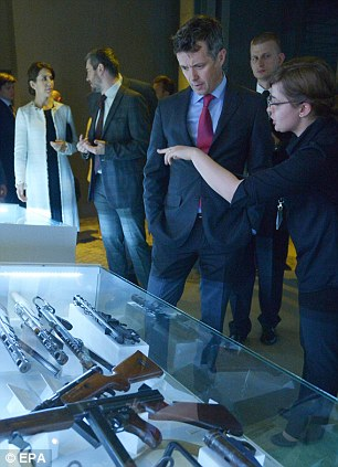 Crown Prince Frederik of Denmark (third right) and Crown Princess Mary of Denmark (left) visit the Warsaw Uprising Museum
