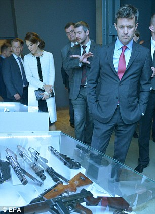 Crown Prince Frederik of Denmark (right) and Crown Princess Mary of Denmark (second left) visit the Warsaw Uprising Museum