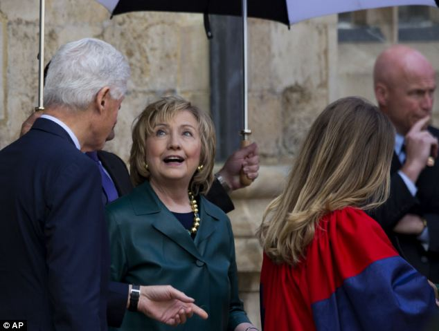 Hillary Clinton (C) attended daughter Chelsea's graduate school commencement at Oxford University on Saturday, while a maelstrom of accusations awaits the former Secretary of State upon her return