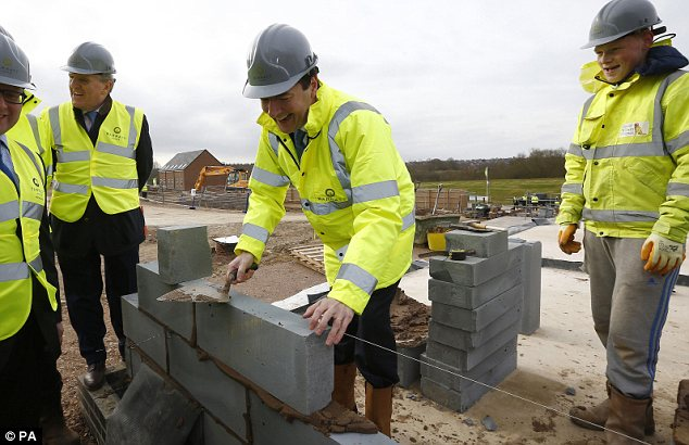 Foundation: George Osborne, Chancellor of the Exchequer lays a block during a visit to a Barratt Homes building site in Nuneaton - will Help To Buy be watered down?