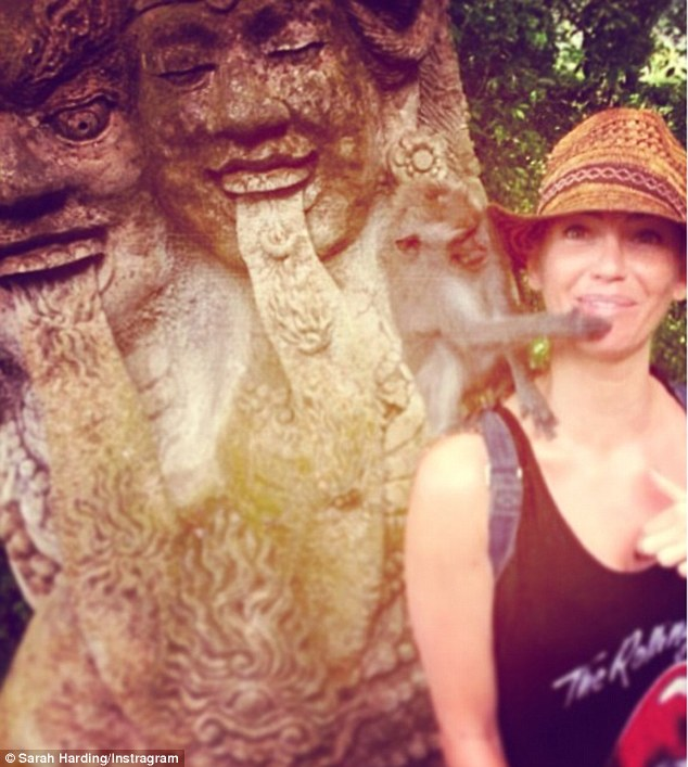 Playful: The former Girls Aloud singer uploaded several snaps of herself and some monkeys during her relaxing trip to Bali